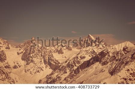 Mountain peaks in winter. Caucasus Mountains. Svaneti region of Georgia. Toned landscape - stock photo