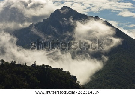 Mountain peaks of Suva Planina at morning covered with clouds in east Serbia - stock photo