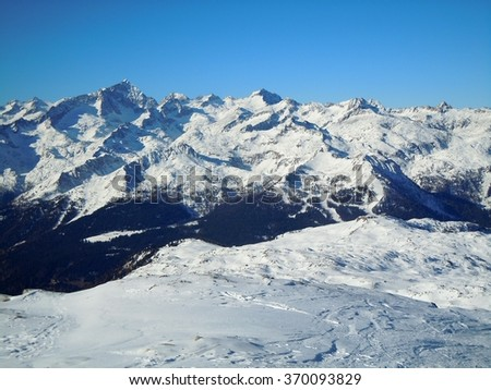 Mountain peaks with snow cover - stock photo