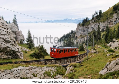 Mountain railway in Swiss Alps - stock photo