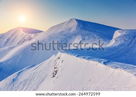 Mountain range glowing by sunlight. View from ski resort Dragobrat. Dramatic morning scene. Carpathian, Ukraine, Europe. Beauty world.  - stock photo