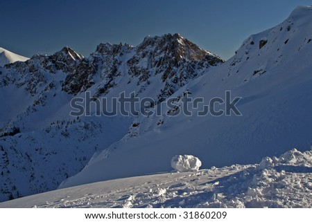 Mountain range in snow. Blue sky and good weather.