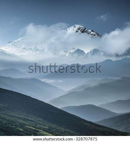 Mountain range in the mist. Beautiful natural landscape - stock photo