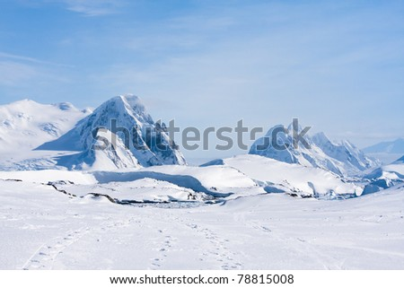 Mountain range is covered with white snow in Antarctica - stock photo