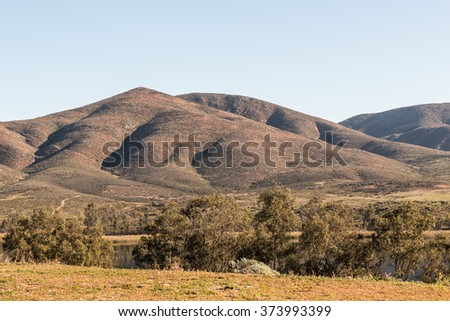 Mountain range, lake and trees at Lower Otay Lake in Chula Vista, California. - stock photo