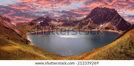 mountain range montafon and artificial lake lunersee, austrian alps - stock photo