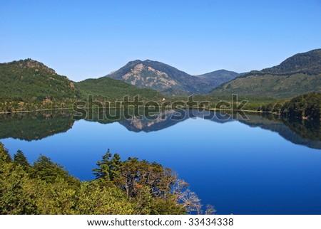 mountain reflection in lake - stock photo