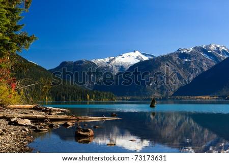 Mountain reflection on Cheakamus Lake at fall. - stock photo