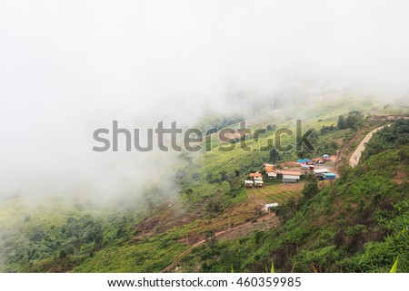 Mountain resort at a fog. - stock photo