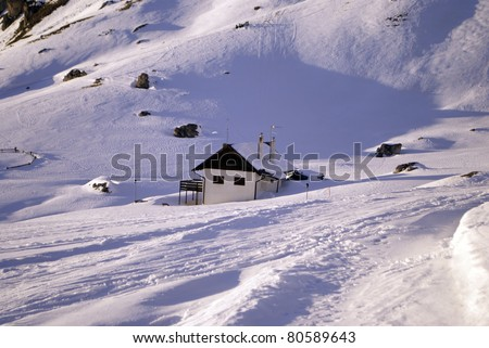 mountain retreat in the Dolomites in winter - stock photo