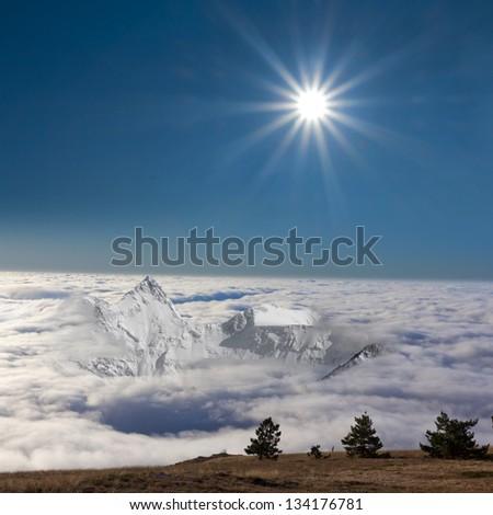 mountain ridge in a dense clouds - stock photo