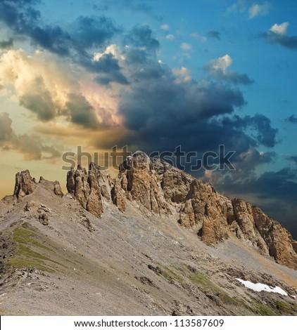 mountain ridge on a evening sky background - stock photo