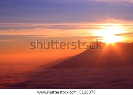 mountain ridge with high cloudiness at sunset time. Babugan, Crimea, Ukraine - stock photo