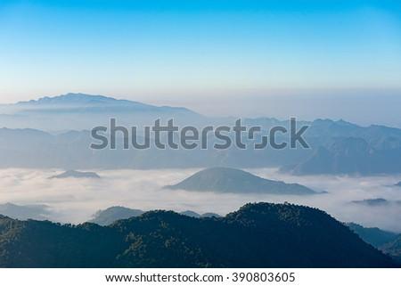 mountain ridge with mist morning, Beautiful mountain ridge for hiking at Doi Tu Lay (Mon Tu Lay) , Tak province Thailand - stock photo