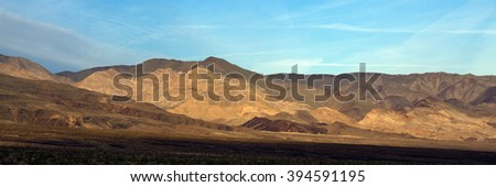 Mountain ridges at sunset in Death Valley National Park - stock photo