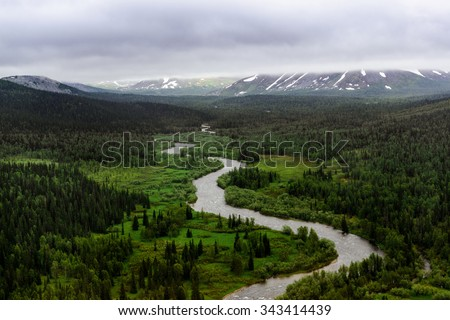 Mountain river among the green forest. National park Yugyd-Va, Polar Ural mountains, Russia. - stock photo