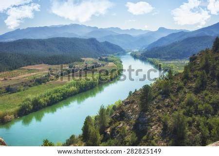 mountain river and colourful mountains of miravet, tarragona, catalonia, spain - stock photo