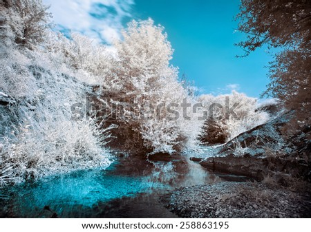 Mountain river bank with trees, Infrared (IR) landscape - stock photo
