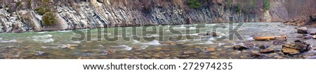 Mountain River Black Cheremosh about Verhovina fast flowing and rocky rapids Carpathian region - early spring. Ecologically clean water, wild mountains around, amid beech and spruce forests and stones