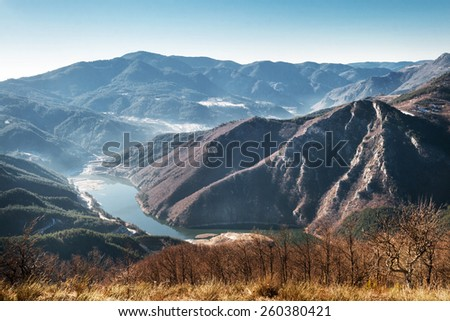 Mountain River Dam and Rocky Hills  - stock photo