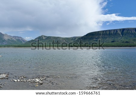 Mountain river Suntar. Landscape of the far corners of the earth in Yakutia. Ridge Suntar-Khayata, Russia.
