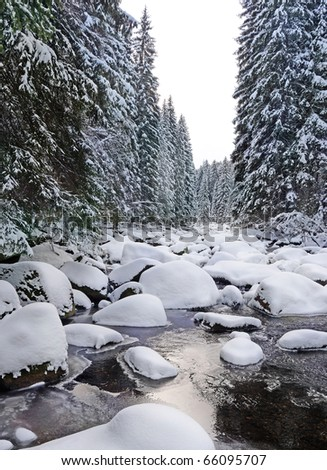 mountain river with big stones in winter time - stock photo