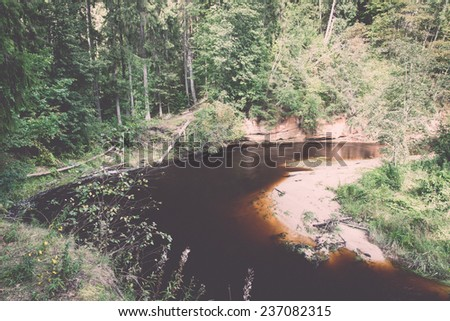Mountain river with Flowing Water Stream and sandstone cliffs - retro, vintage style look