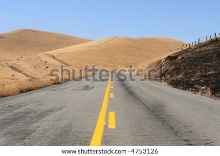 Mountain road. - stock photo