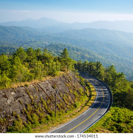 Mountain road and a scenic mountain view - stock photo