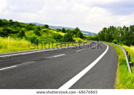 Mountain road and blue sky - stock photo