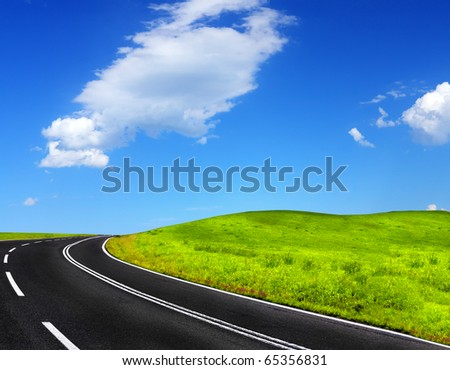 Mountain road and cloudy sky - stock photo