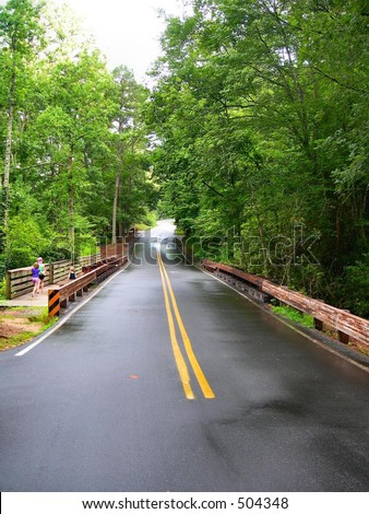 Mountain Road and Trail - stock photo