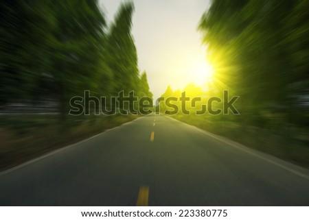 Mountain road at dusk - stock photo