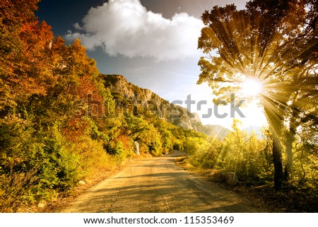 Mountain road at sunset - stock photo