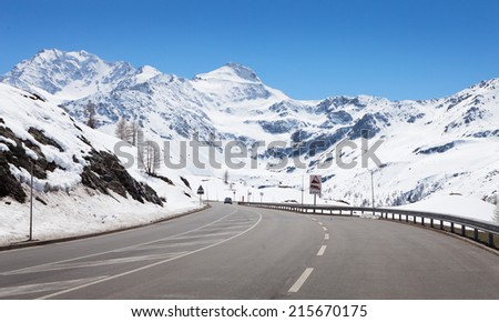 Mountain road in a sunny day (Swiss alps).  Simplon Pass, Valais, Switzerland - stock photo