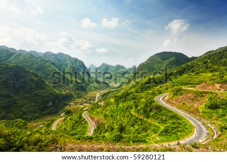 Mountain road in beautiful valley. Ha Giang province. Vietnam - stock photo
