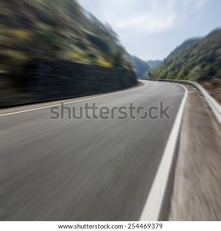 Mountain road in cars - stock photo