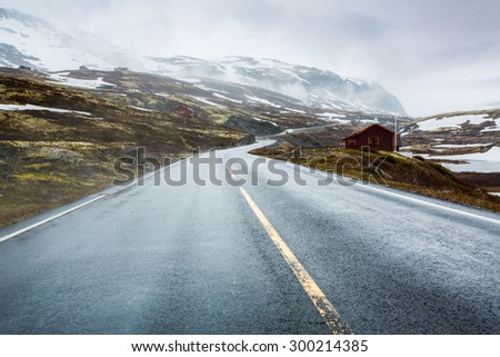 Mountain road in Norway, around the fog and snow. - stock photo