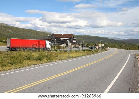 Mountain road in Norway, Oppland county. Roadside parking and motel in the middle of nowhere. - stock photo