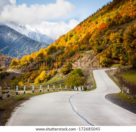 Mountain road in the autumn in the mountains - stock photo