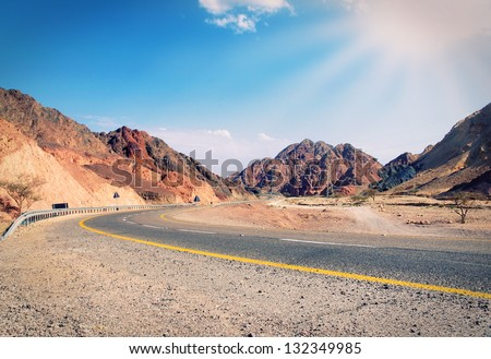 mountain road in the summer - stock photo