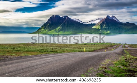 Mountain road leading to the peaks and fjords, Iceland - stock photo
