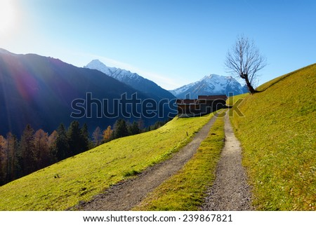 Mountain road to the hut - stock photo