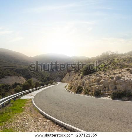 mountain road turn - stock photo