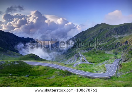 mountain road with clouds, Romanian Carpathians, Transfagarasan - stock photo