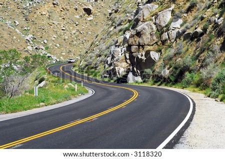mountain road with dangerous curves - stock photo