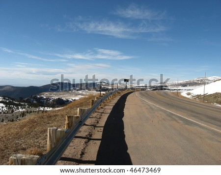 mountain road with guard rail - stock photo