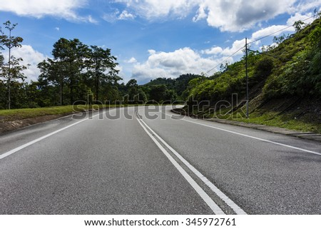 mountain road with sunny sky