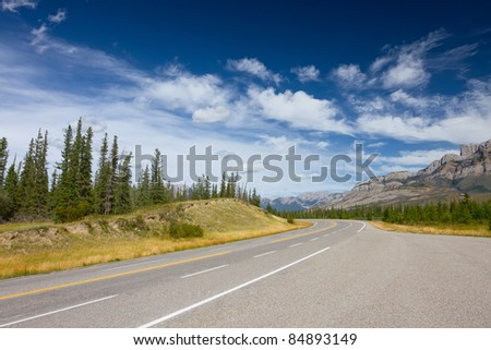 Mountain Road (Yellowhead Highway) with Painted Double Yellow Line. Photo is taken in Jasper National Park, Alberta, Canada - stock photo