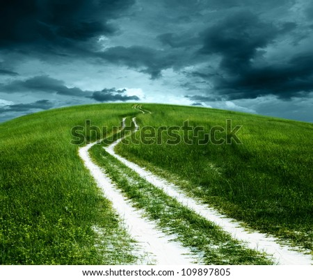 Mountain roads grass. - stock photo